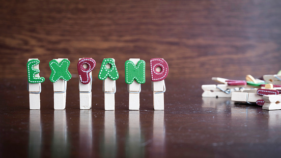 Expand Word On Clothes Peg Stick Stock Photo - Download Image Now