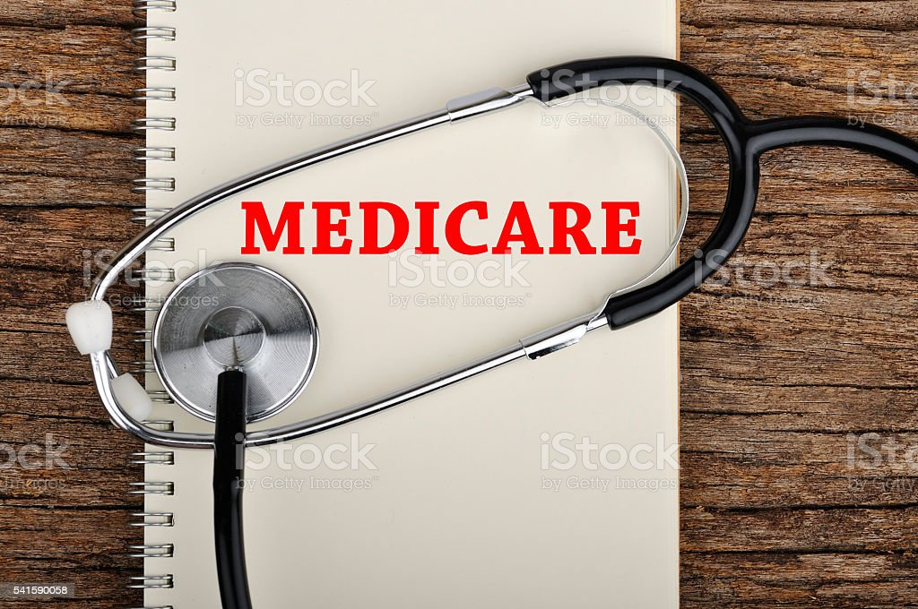 'MEDICARE' Word on Notebook With Stethoscope stock photo