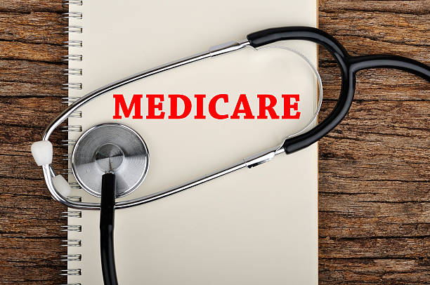 """""""medicare"""" word on notebook with stethoscope - outpatient stock pictures, royalty-free photos & images"""