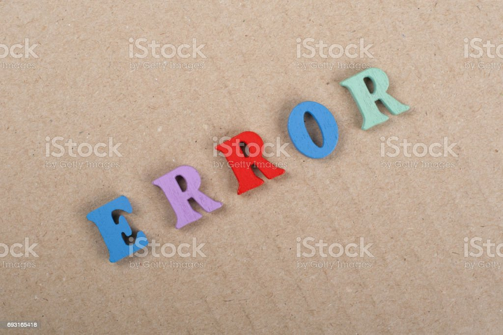 ERROR word on paper background composed from colorful abc alphabet block wooden letters, copy space for ad text. Learning english concept stock photo