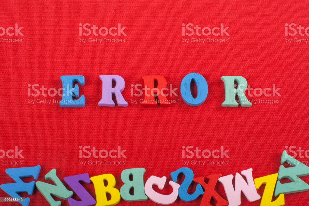 ERROR word on red background composed from colorful abc alphabet block wooden letters, copy space for ad text. Learning english concept stock photo