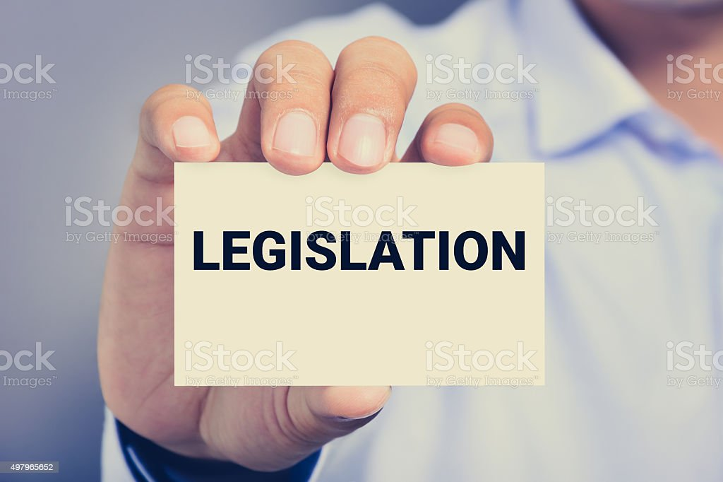 LEGISLATION word  on the card shown by a man stock photo
