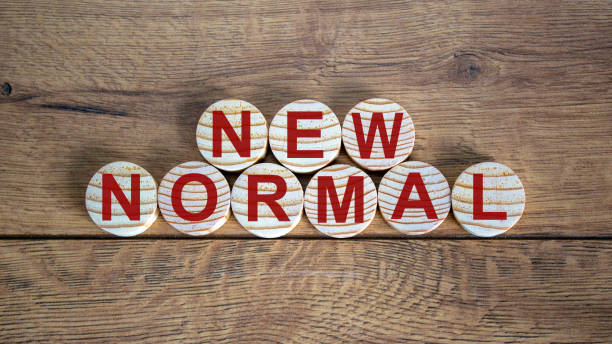 new normal word on wooden alphabet circles. new normal concept. beautiful wooden background. - new normal foto e immagini stock