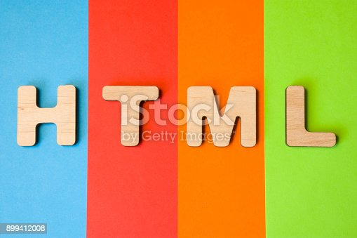 istock Word or abbreviation HTML, meaning HyperText Markup Language as internet programming language, is on background of four colors: blue, red, orange and green. HTML symbol as  programming language 899412008
