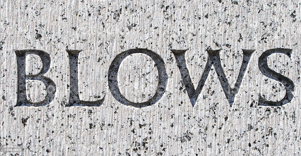 "Word ""Blows"" Carved in Gray Granite royalty-free stock photo"