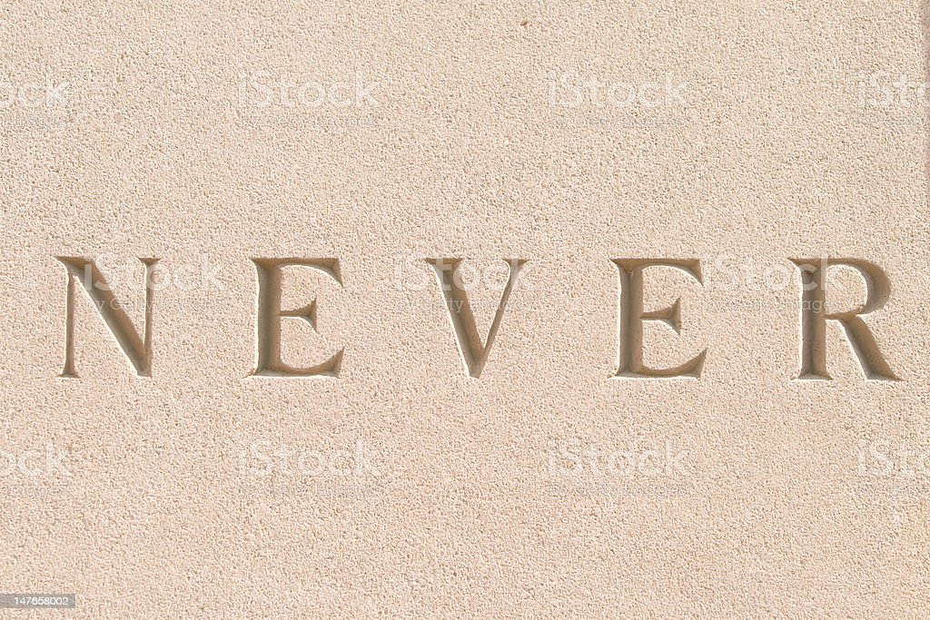 "Word ""Never"" Carved in Sandstone royalty-free stock photo"