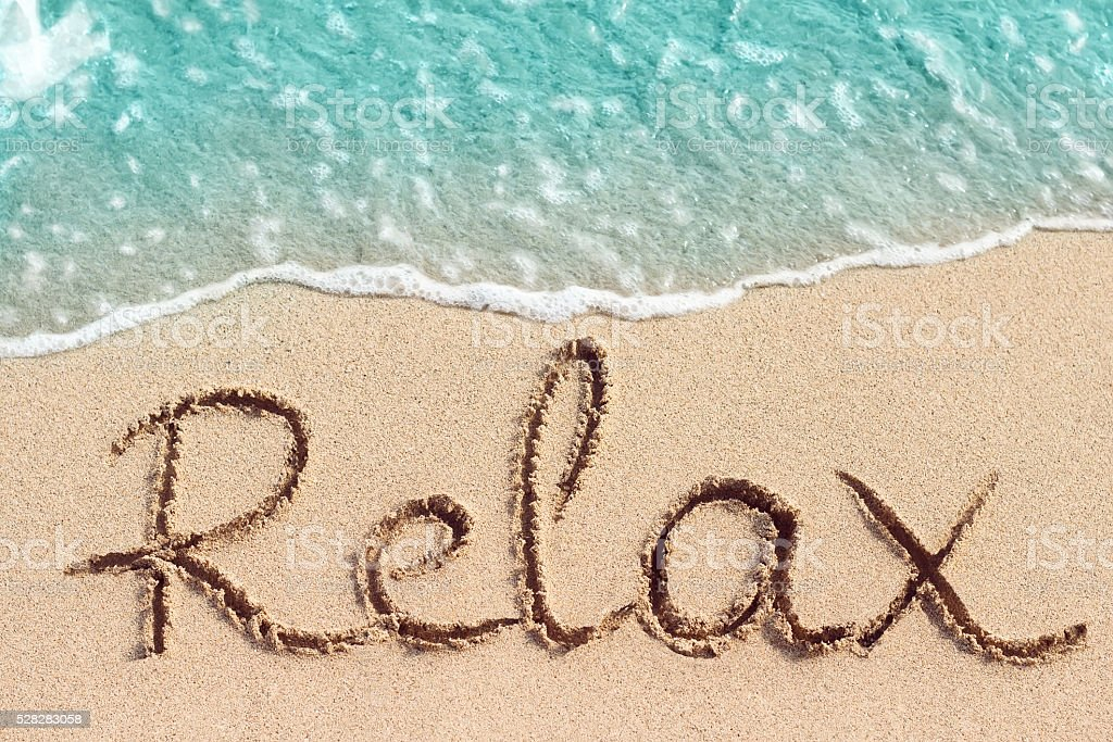 Word Relax handwritten on sandy beach - Royalty-free Handwriting Stock Photo
