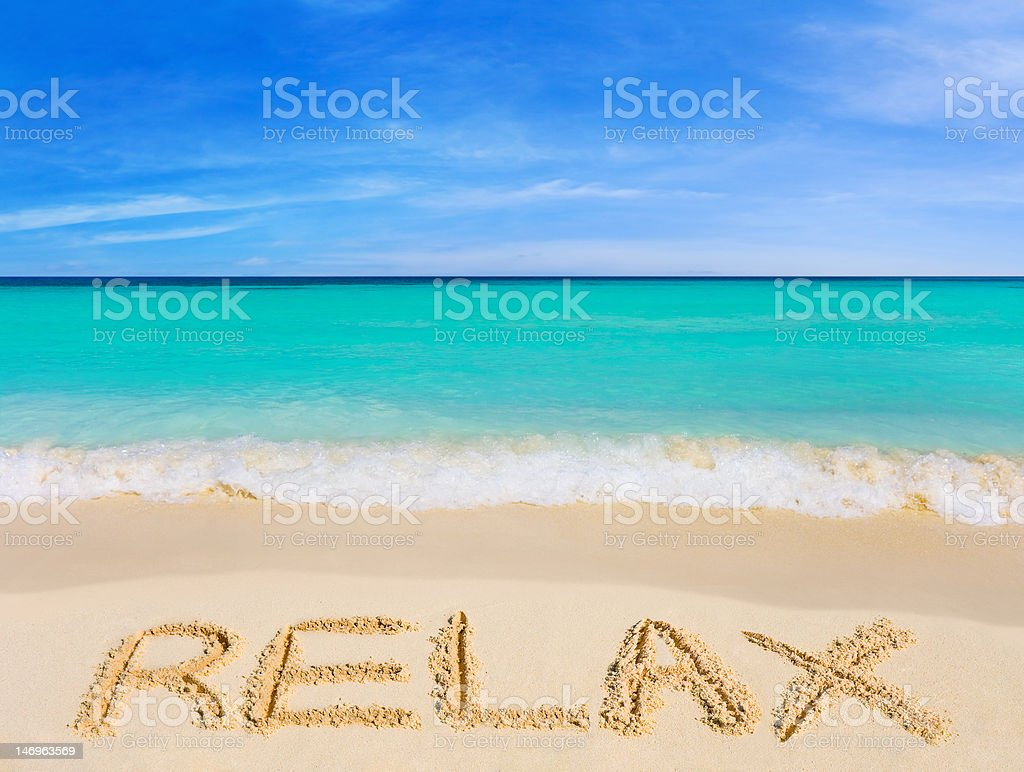 Word Relax on beach stock photo