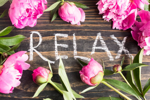 Word Relax with Pink Peonies stock photo
