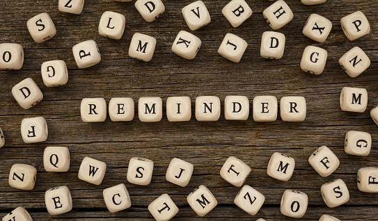 Word REMINDER written on wood block,stock image