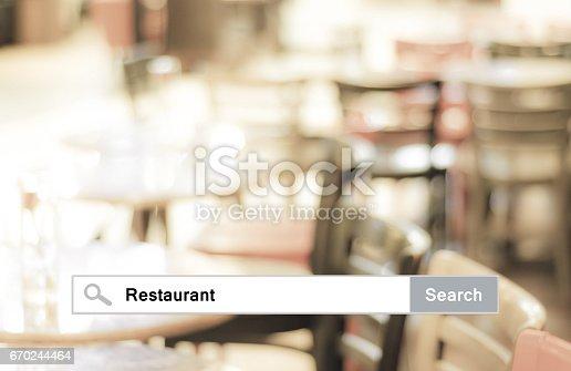 istock Word Restaurant written on search bar over blur restaurant background, web banner, restaurant reservation, food online, food delivery concept 670244464