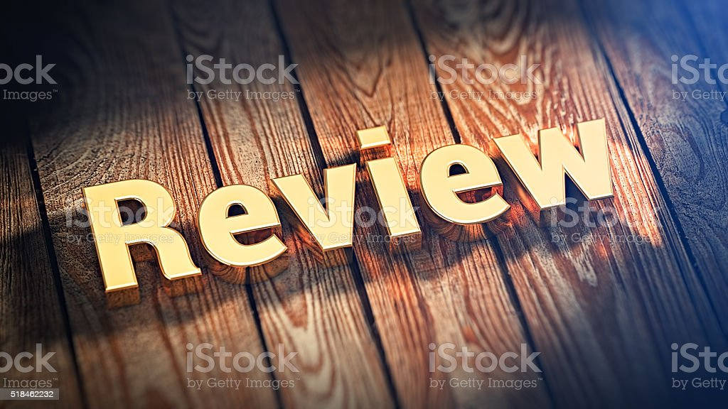Word Review on wood planks stock photo