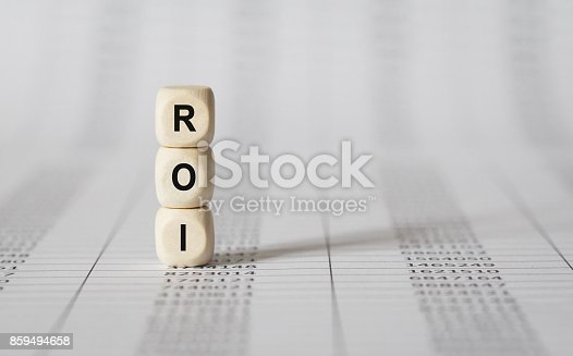 istock Word ROI made with wood building blocks 859494658