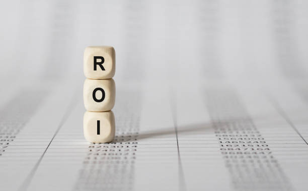 Word ROI made with wood building blocks stock photo