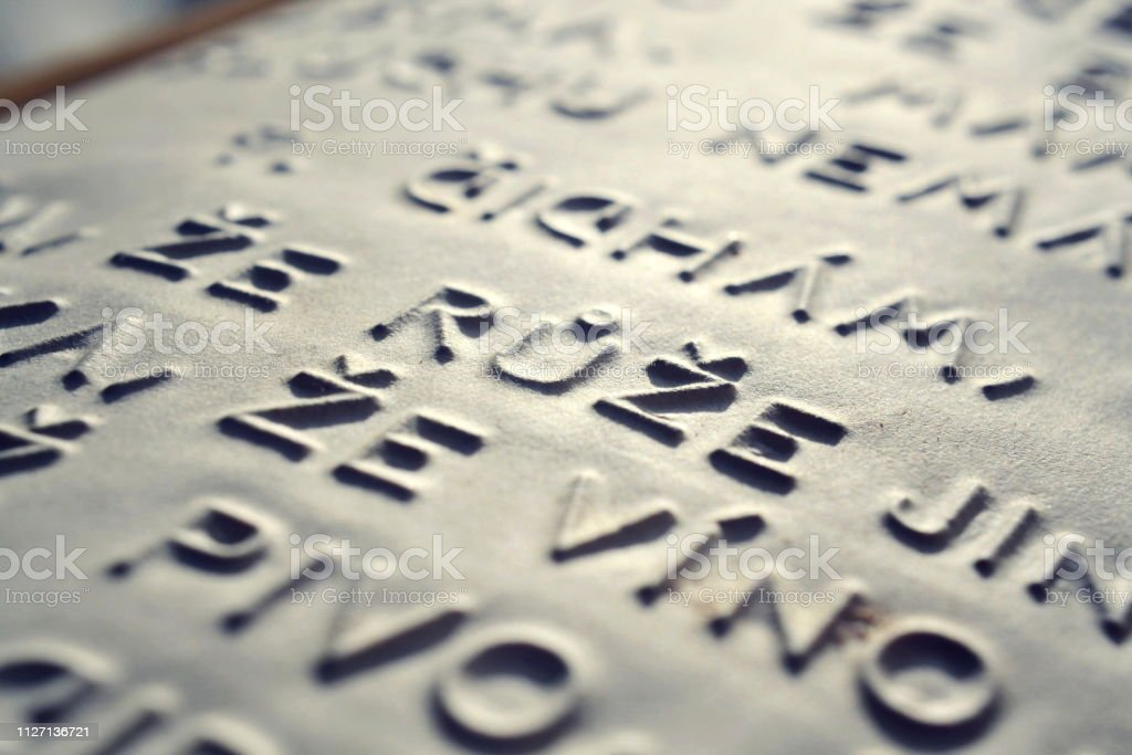 Word rose in Czech language embossed writing letters for blind people used before Braille writing system stock photo