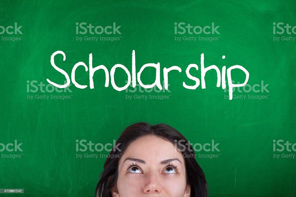Word scholarship on chalkboard stock photo