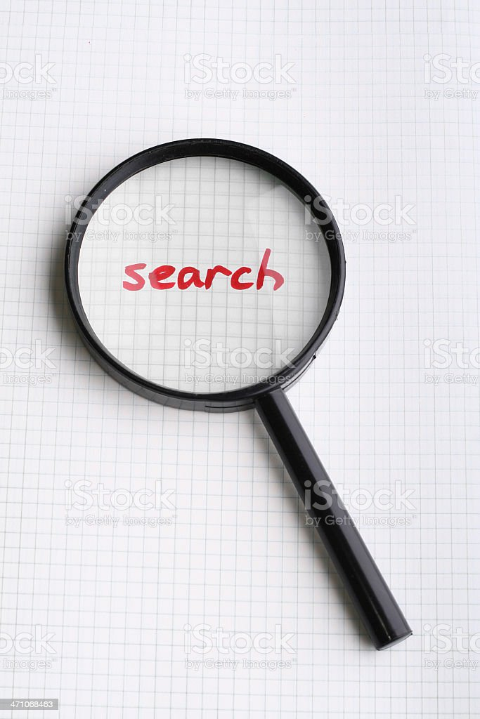 word SEARCH under magnifying glass royalty-free stock photo