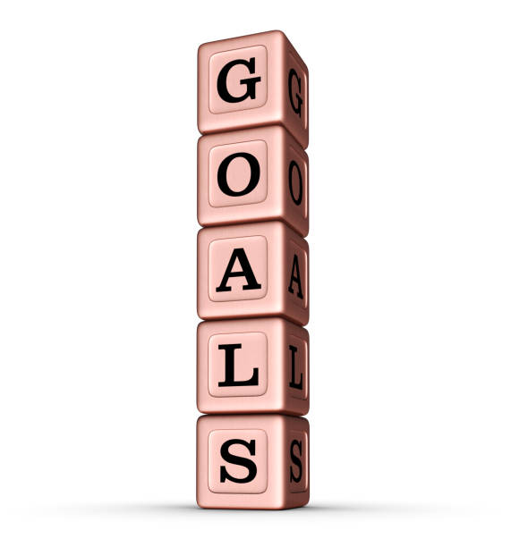 GOALS word sign. Vertical Stack of Rose Gold Toy Blocks. stock photo
