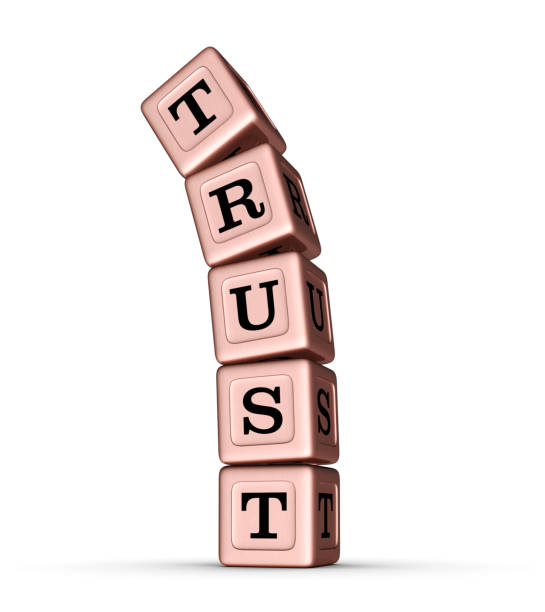 TRUST word sign. Vertical Stack of Rose Gold Toy Blocks. stock photo