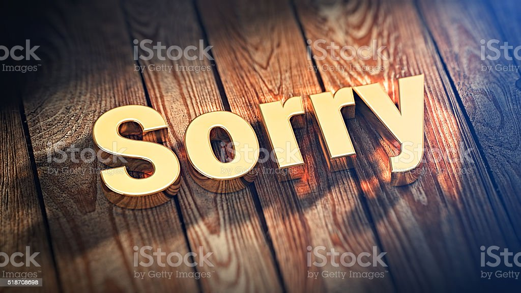 Word Sorry on wood planks stock photo