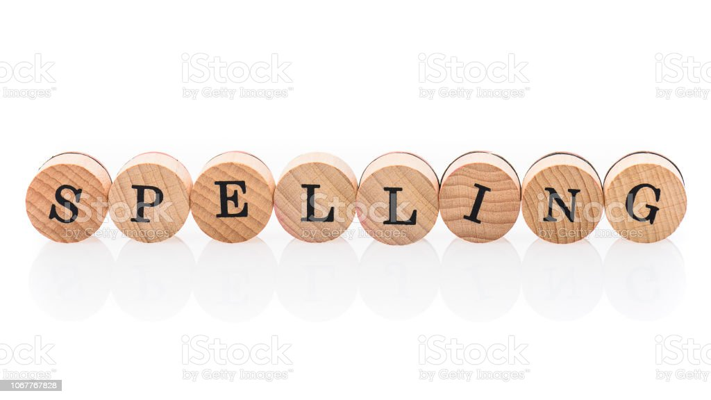 Word Spelling from circular wooden tiles with letters children toy. stock photo