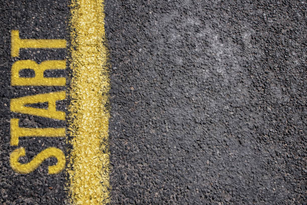 word start written on an asphalt road background - beginnings stock photos and pictures
