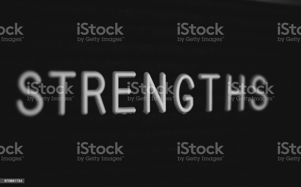 Word strengths written on the letter board. stock photo
