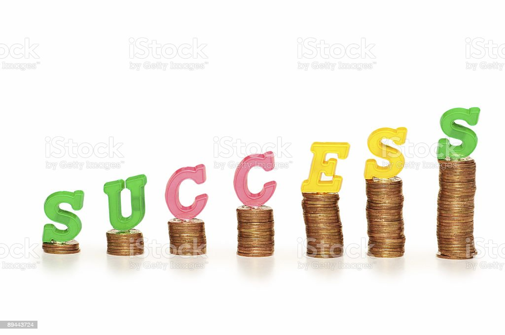 Word 'Success' on top of coin stacks royalty-free stock photo