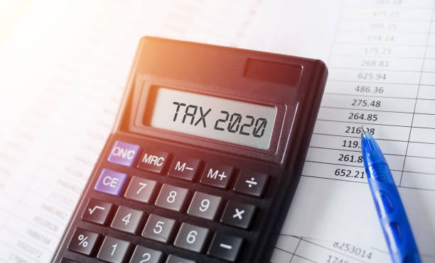 word tax 2020 on calculator. business and tax concept. - tax laws stock pictures, royalty-free photos & images