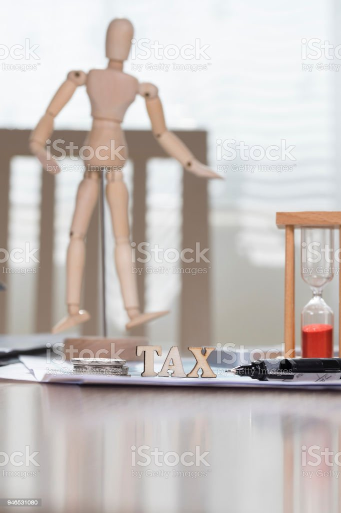 Word TAX composed of wooden letters. stock photo