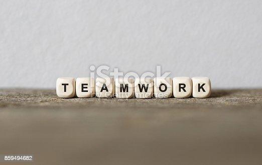 istock Word TEAMWORK made with wood building blocks 859494682