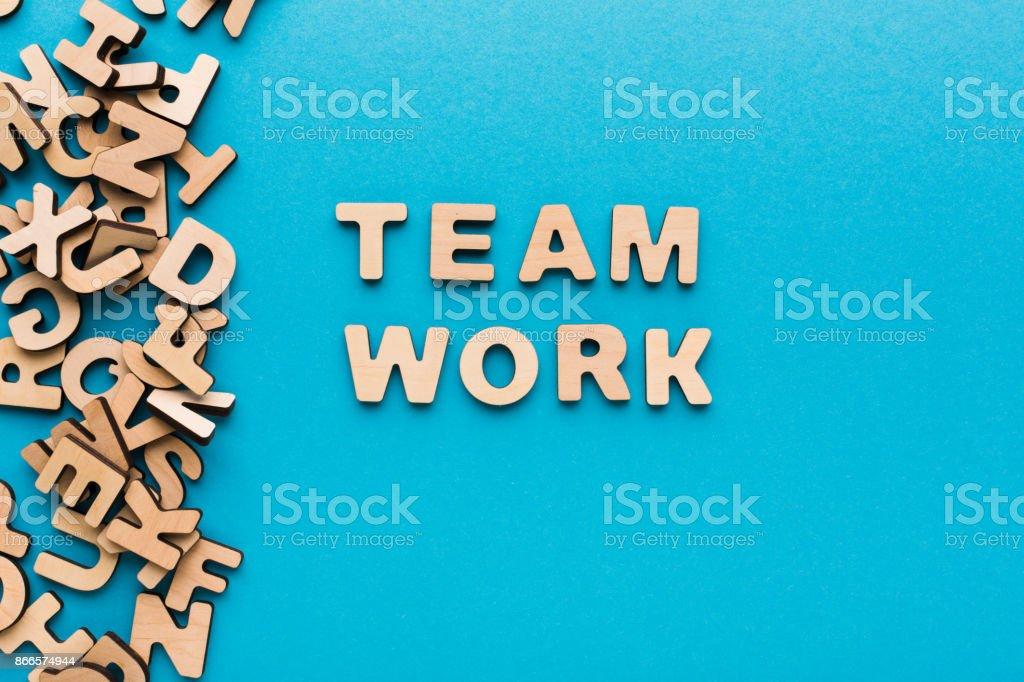 Word Teamwork on blue background stock photo