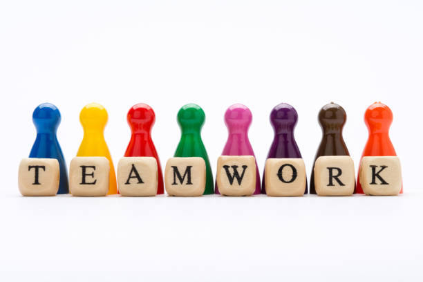 Word teamwork on wooden blocks and pawns in various colors on white background, as a concept of success and diversity Word teamwork on wooden blocks and pawns in various colors on white background, as a concept of success and diversity surrounding stock pictures, royalty-free photos & images