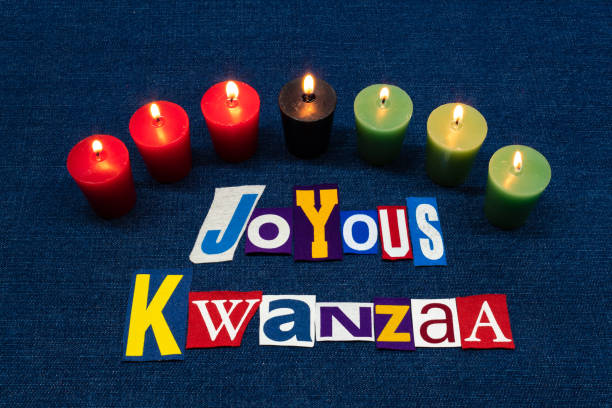 joyous kwanzaa word text collage typography, seven candles and multi colored fabric on blue denim, african american holiday - kwanzaa stock pictures, royalty-free photos & images