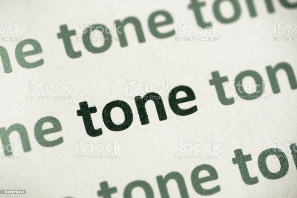 word tone printed on paper macro stock photo