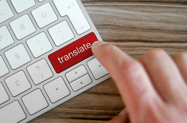 word translate on computer keyboard - translator stock photos and pictures