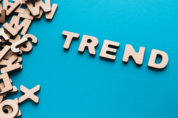 word trend on blue background - word game stock pictures, royalty-free photos & images