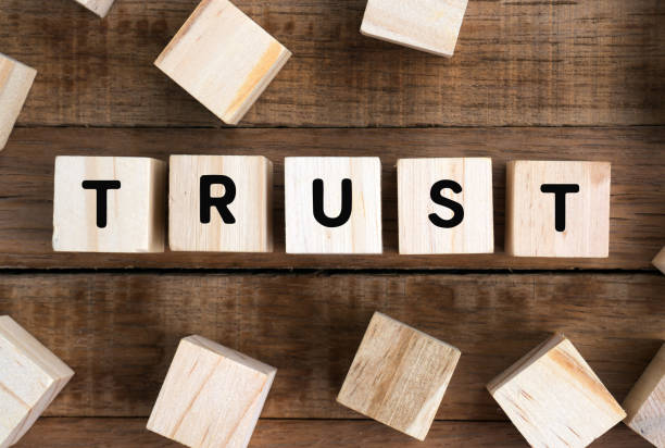 Word trust on a wooden block stock photo