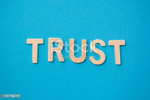 istock word trust with wooden alphabet letter on blue background 1157162741