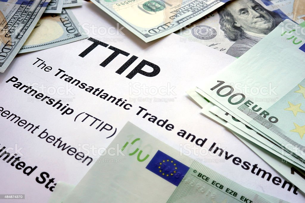 Word TTIP on a paper with dollars and euros. stock photo