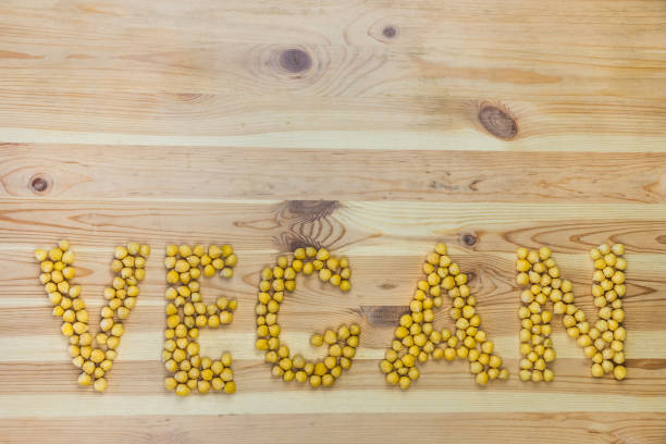word vegan made of chickpeas - food logo stock photos and pictures