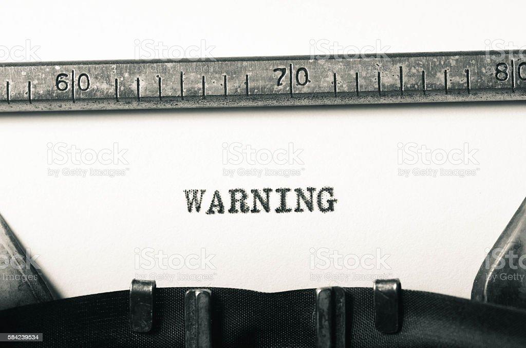 word warning  typed on typewriter stock photo
