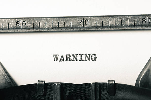 word warning  typed on typewriter stock photo