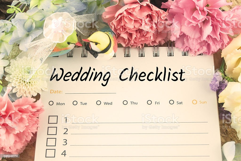 word wedding checklist note paper on pink flower royalty-free stock photo
