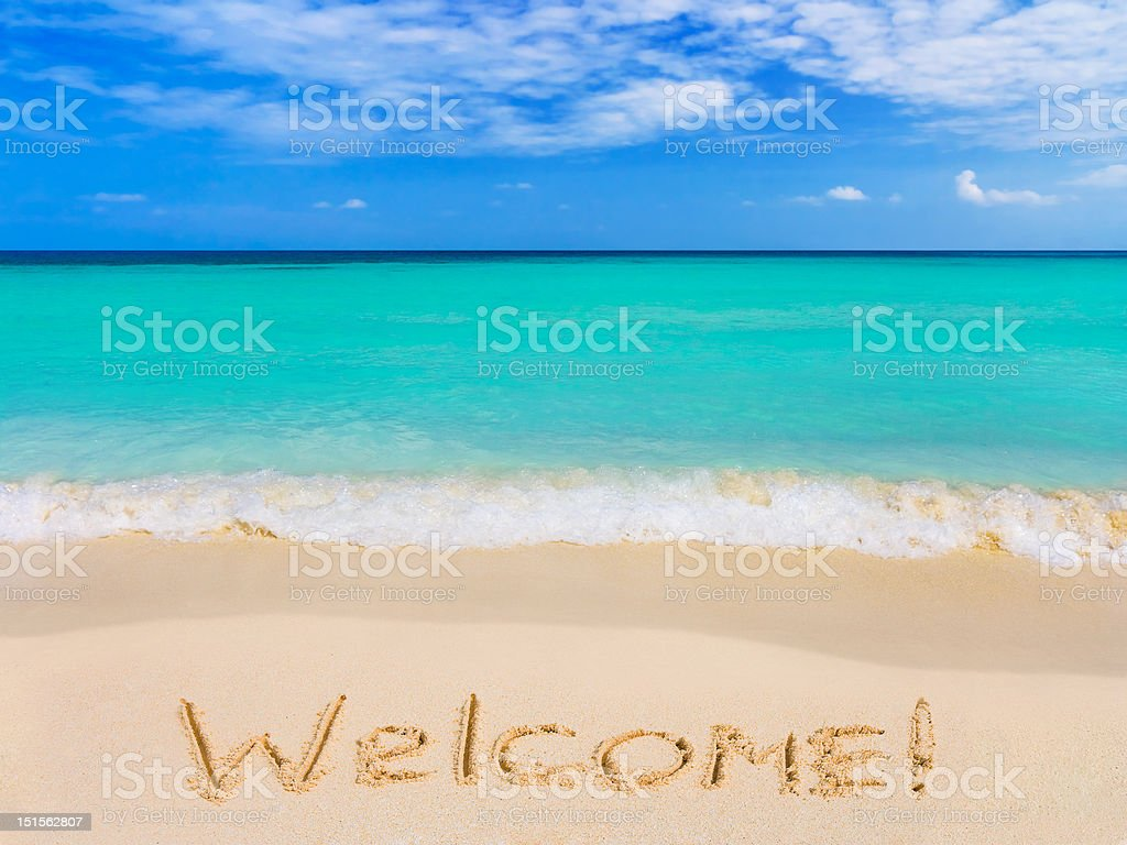 Word Welcome on beach stock photo