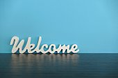Word welcome on blue background
