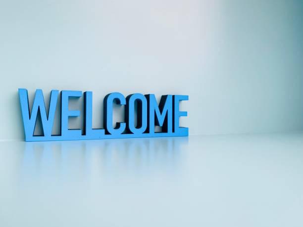 Wort willkommen auf blaue weiche backbground – Foto