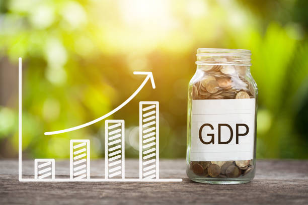 GDP Word With Coin In Glass Jar and graph up. Financial Concept. stock photo