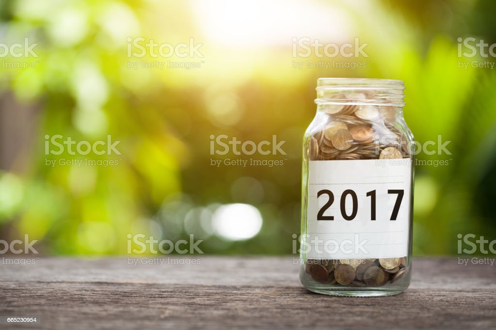 2017 word with coin in glass jar,  Business Concept. stock photo
