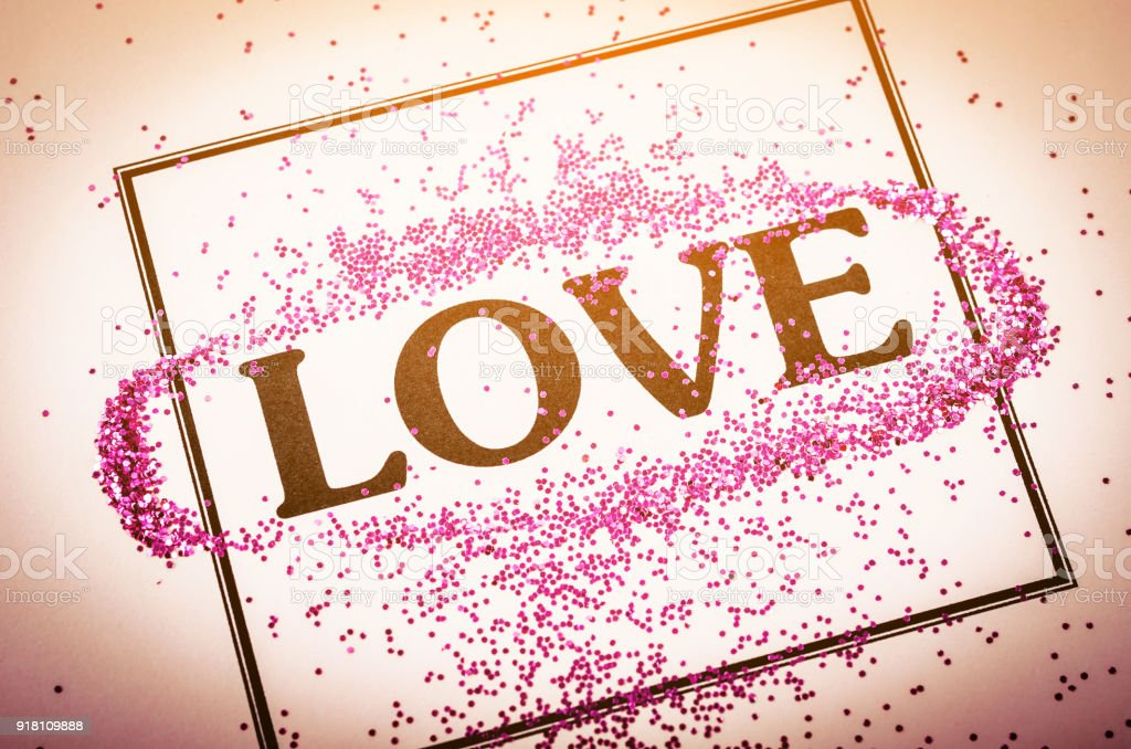 Love Word With Glitter In Frame On Beautiful Paper Stock Photo ...